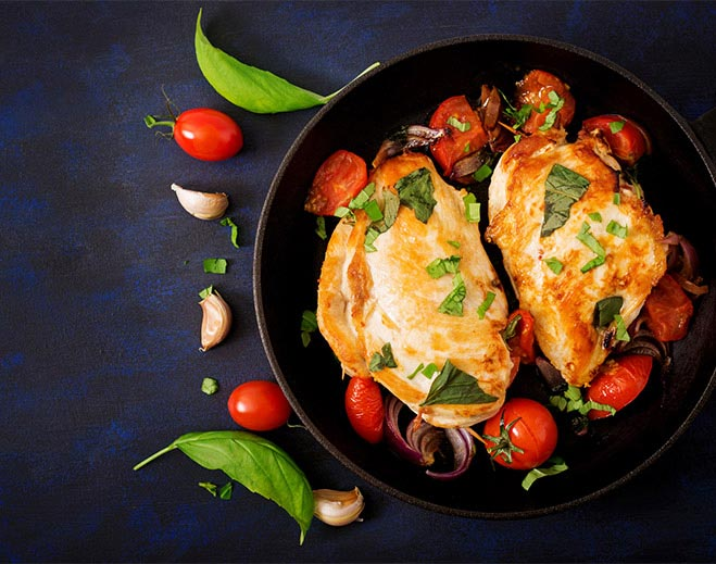 Image of chicken breasts simmering in tomato sauce