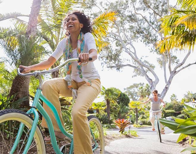 Happy Mature woman riding a bike