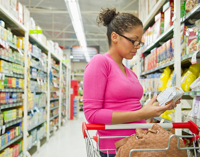 Women reading nutrition labels